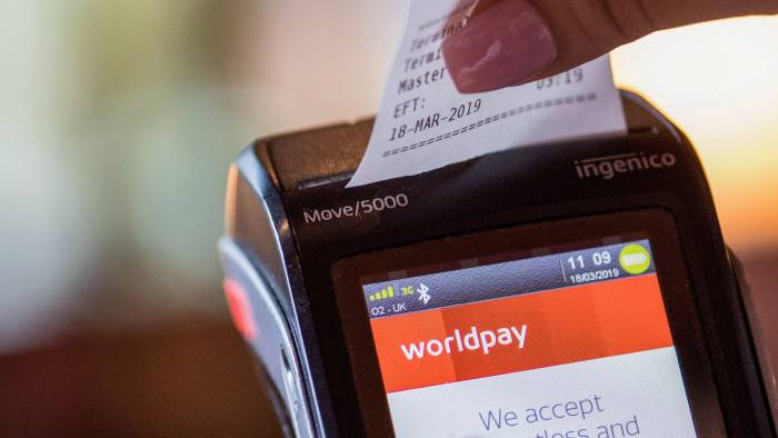 A waitress tears a receipt from a Worldpay Inc. payment terminal at a restaurant in this arranged photograph in London, U.K., on Monday, March 18, 2019. Fidelity National Information Services Inc. agreed to acquireWorldpay Inc.for about $34 billion in cash and stock, the biggest deal ever in the booming international payments sector. Photographer: Jason Alden/Bloomberg