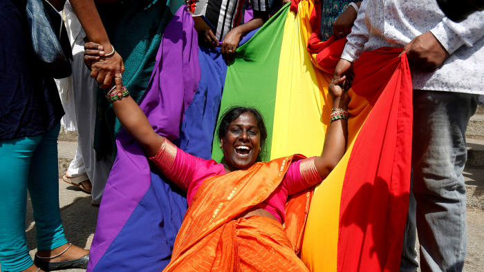 An activist of lesbian, gay, bisexual and transgender (LGBT) community celebrates after the Supreme Court's verdict of decriminalizing gay sex and revocation of the Section 377 law, in Bengaluru, India, September 6, 2018. REUTERS/Abhishek N. Chinnappa      TPX IMAGES OF THE DAY - RC19DE7B83C0
