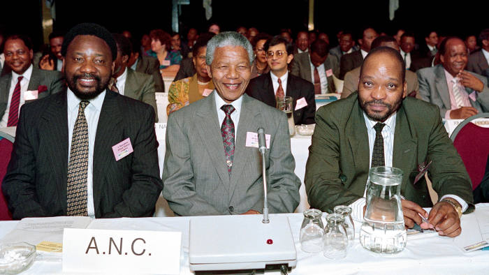 (from left), Cyril Ramaphosa, Nelson Mandela and Jacob Zuma, representatives of the African National Congress (ANC) attend a two-day Convention for a Democratic South Africa (CODESA), on December 20, 1991, in Johannesburg. AFP PHOTO WALTER DHLADHLA / AFP PHOTO / WALTER DHLADHLA (Photo credit should read WALTER DHLADHLA/AFP/Getty Images)
