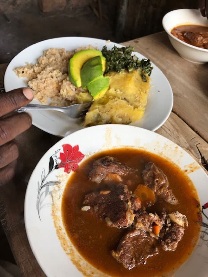Staple diet: the beef stew 'nyama' with some 'matoke', rice, avocado and 'dodo' greens on the side