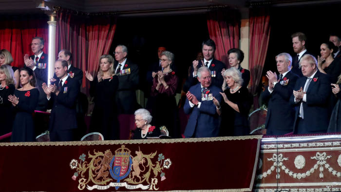 Britain's Queen Elizabeth II (C), with (L-R) Catherine, Duchess of Cambridge, Prince William, Duke of Cambridge, Prince Edward, Earl of Wessex, Sophie, Countess of Wessex, Birgitte, Duchess of Gloucester, Sir Tim Laurence, Prince Charles, Prince of Wales, Princess Anne, Princess Royal, Camilla, Duchess of Cornwall, Prince Andrew, Duke of York, Prime Minister Boris Johnson, Prince Harry, Duke of Sussex, Meghan, Duchess of Sussex and Carrie Symonds attend the annual Royal British Legion Festival of Remembrance at the Royal Albert Hall in London on November 9, 2019. (Photo by Chris Jackson / POOL / AFP) (Photo by CHRIS JACKSON/POOL/AFP via Getty Images)