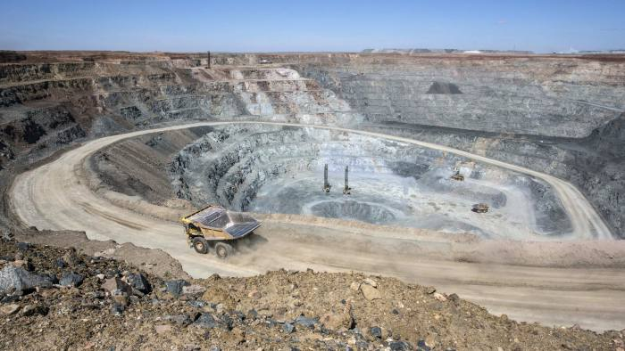 Dump trucks operate in an open pit at the Oyu Tolgoi copper-gold mine, jointly owned by Rio Tinto Group's Turquoise Hill Resources Ltd. unit and state-owned Erdenes Oyu Tolgoi LLC, in Khanbogd, the South Gobi desert, Mongolia, on Saturday, July 23, 2016. Mongolia exported 817,000 tons of copper concentrate in the first half of the year compared with 663,800 tons a year earlier, an increase of 23.1 percent. Photographer: Taylor Weidman/Bloomberg