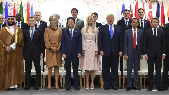29 June 2019, Japan, Osaka: Saudi Crown Prince Mohammed bin Salman (L-R, first row), Argentinian President Mauricio Macri, Queen Maxima of the Netherlands, Japanese Prime Minister Shinzo Abe, US President Donald Trump's Adviser Ivanka Trump, US President Donald Trump, Indonesian President Joko Widodo and French President Emmanuel Macron pose for a group picture of the Leader's Special Event on Women's Empowerment at G20 Summit with Chilean President Sebastian Pinera (L-R, second row), Senegal's President Macky Sall, Australian Prime Minister Scott Morrison, British Prime Minister Theresa May, Canadian Prime Minister Justin Trudeau, Italian Prime Minister Giuseppe Conte, Spanish Prime Minister Pedro Sanchez and Dutch Prime Minister Mark Rutte. Photo: Lukas Coch/AAP/dpa