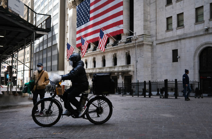NEW YORK, NY - APRIL 02: A person rides a bike down Wall Street on April 02, 2020 in New York City. Hospitals in New York City, which has been especially hard hit by the coronavirus, are facing shortages of beds, ventilators and protective equipment for medical staff. Currently, over 92,000 people in New York state have tested positive for COVID-19. (Photo by Spencer Platt/Getty Images)