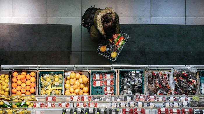 FILE: A shopper browses fresh fruit and vegetables in the foodhall inside a branch of Marks & Spencer Group Plc (M&S) in London, U.K., on Tuesday, Dec. 5, 2017. A decline in sales of food and clothing in the fourth quarter underlined the need for a restructuring of the 134-year-old retailer, including plans to shut nearly one-third of its large stores in the U.K. Our editors select the best archive images of M&S as profits drop 62% and store closures planned. Photographer: Luke MacGregor/Bloomberg