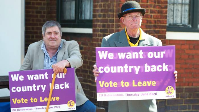 "United Kingdom Independence Party (UKIP) supports hold placards as they wait the party's leader, Nigel Farage (unseen) to arrive to campaign to leave the European Union, ahead of the June 23 referendum, in Dagenham, east of London on May 23, 2016. Leaving the European Union would tip Britain into a ""year-long recession"", finance minister George Osborne warned Monday as campaigning stepped up a month from a referendum on membership of the bloc. / AFP PHOTO / NIKLAS HALLE'NNIKLAS HALLE'N/AFP/Getty Images"