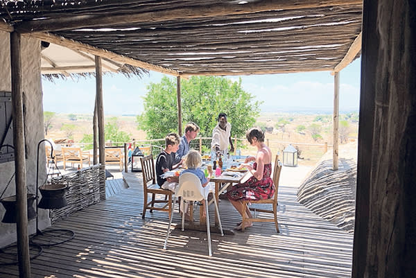 Horatio Clare and his family having lunch at Mkombe's House, a lodge in Kogatende