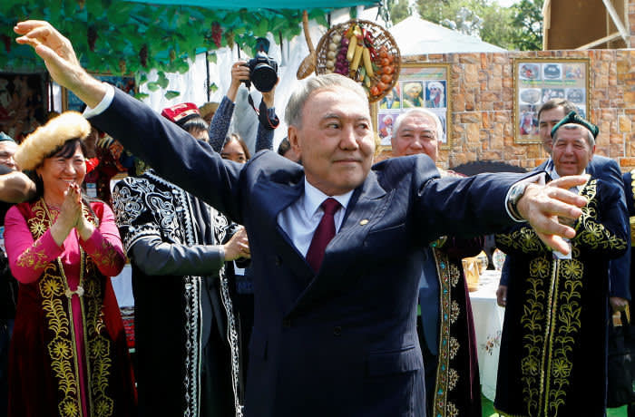 Kazakhstan's President Nursultan Nazarbayev dances with the participants of a performance during celebrations on People's Unity Day in Almaty, Kazakhstan May 1, 2016. REUTERS/Shamil Zhumatov