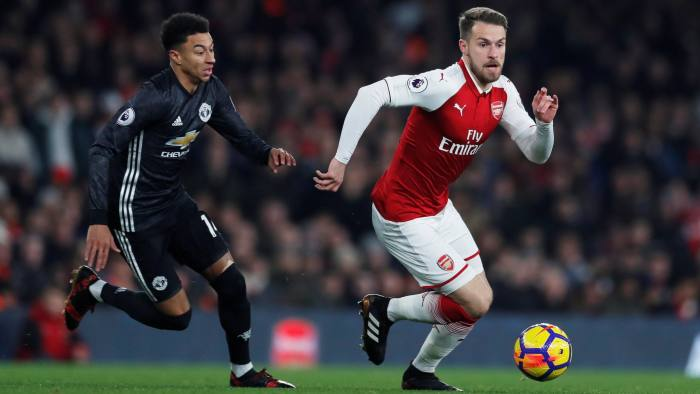 """Soccer Football - Premier League - Arsenal vs Manchester United - Emirates Stadium, London, Britain - December 2, 2017   Arsenal's Aaron Ramsey in action with Manchester United's Jesse Lingard    Action Images via Reuters/Andrew Couldridge    EDITORIAL USE ONLY. No use with unauthorized audio, video, data, fixture lists, club/league logos or """"live"""" services. Online in-match use limited to 75 images, no video emulation. No use in betting, games or single club/league/player publications. Please contact your account representative for further details."""