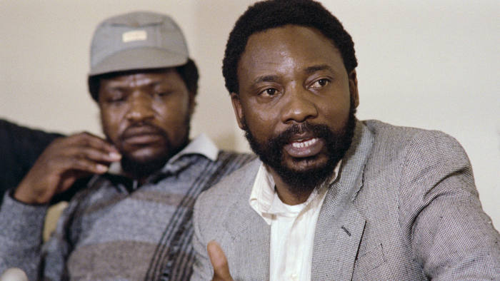 Secretary General of National Union of Mineworkers (NUM), Cyril Ramaphosa, gives a press conference, on August 30, 1987, in Johannesburg. (Photo credit should read WALTER DHLADHLA/AFP/Getty Images)