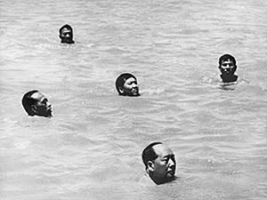 A retouched picture released by the Chinese official news agency shows Chairman Mao Zedong (C, bottom) surrounded by his bodyguards, swimming 16 July 1966, in the Yangtze river, near Wuhan, to prove he was still in a fighting spirit