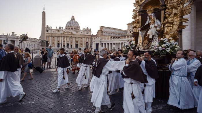 ROME, ITALY - JULY 15: Solemn Celebration and processions in honor of Madonna del Carmine in the Rione Borgo at Via della Conciliazione on July 15, 2018 in Rome, Italy. The statue of the Madonna weighing 15 quintals is carried by the bearers  of the Venerable Confraternity of the Scapular of St. Mary of Mount Carmel, founded in 1527, in the church of Santa Maria in Traspontina . (Photo by Stefano Montesi - Corbis/Getty Images)