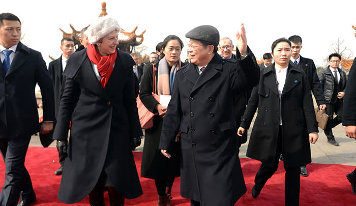 British Prime Minister Theresa May, accompanied by Chen Yixin, the Communist Party boss of Wuhan, watch an opera show during a tour to the ancient Huanghelou Tower in Wuhan in central China's Hubei province Wednesday Jan. 31, 2018. Photo via Newscom