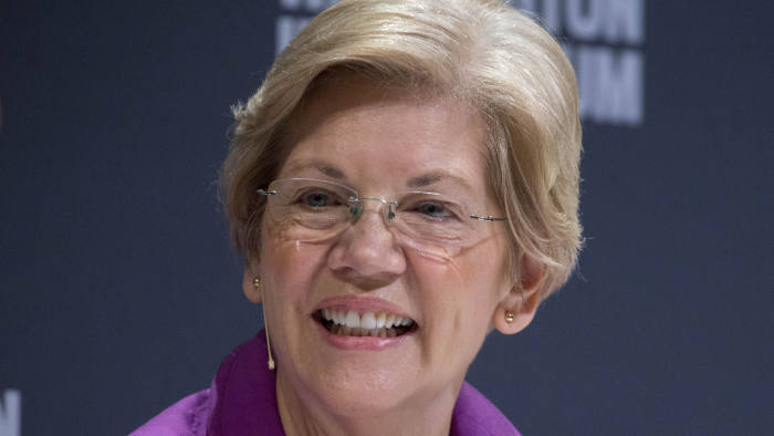 Senator Elizabeth Warren, a Democrat from Massachusetts, smiles during an interview at the Washington Ideas Forum in Washington, D.C., U.S., on Thursday, Oct. 1, 2015. Hosted by the Atlantic in partnership with the Aspen Institute, the forum identifies the year's most pressing issues and ideas of consequence covering the biggest newsmaking topics of the moment. Photographer: Andrew Harrer/Bloomberg