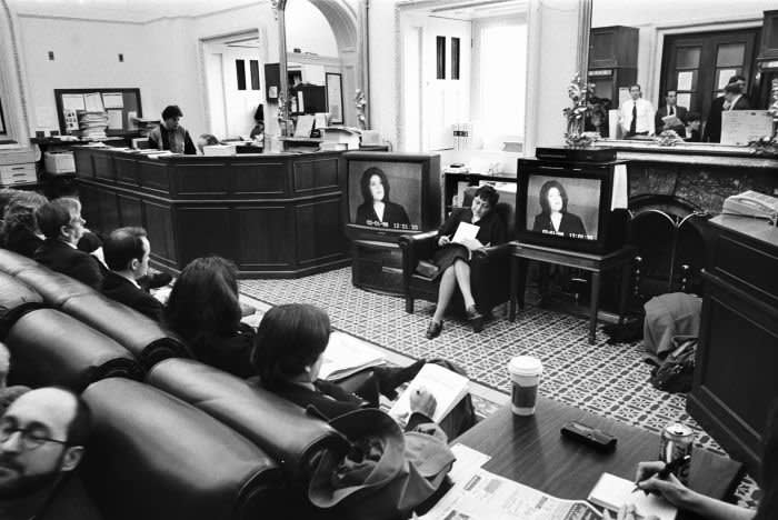 Reporters listen remotely to the testimony of Monica Lewinsky during the Bill Clinton impeachment trial in the Senate in 1999 in Washington DC