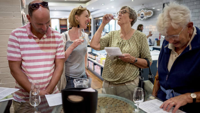 Visitors taste wines at Chapel Down Winery in Kent on August 13, 2018.