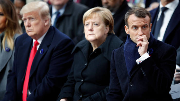 MAXPPP OUT Mandatory Credit: Photo by FRANCOIS MORI/POOL/EPA-EFE/REX/Shutterstock (9973500cp) (L-R) US President Donald J. Trump, German Chancellor Angela Merkel and French President Emmanuel Macron attend the international ceremony for the Centenary of the WWI Armistice of 11 November 1918 at the Arc de Triomphe, in Paris, France, 11 November 2018. World leaders have gathered in France to mark the 100th anniversary of the First World War Armistice with services taking place across the world to commemorate the occasion. Commemoration of the Centenary of the end of the First World War, Paris, France - 11 Nov 2018