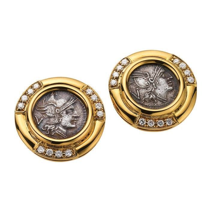 Earrings in gold with Roman Republican silver coins and diamonds, ca 1985. Each set at the centre with a Roman quinarius, 3rd Century BC in a circular frame partially pave set with brilliant-cut diamonds. Two quinari from the mint of Rome (211–210 B.C.) Marks: on both clip mechanisms: