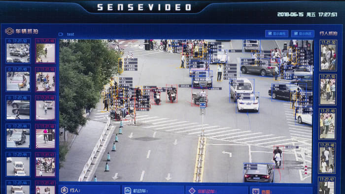 A screen shows a demonstration of SenseTime Group Ltd.'s SenseVideo pedestrian and vehicle recognition system at the company's showroom in Beijing, China, on Friday, June 15, 2018. SenseTime's image-identifying algorithms have made it the world's most valuable AI startup and an early leader in China, where it's won contracts with the country's top phonemakers, largest telecommunications company, and biggest retailer. Photographer: Gilles Sabrie/Bloomberg