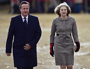 LONDON, ENGLAND - OCTOBER 21:  Prime Minister David Cameron and Home Secretary Theresa May arrive for a ceremonial welcome for the President of Singapore at Horse Guards Parade on October 21, 2014 in London, England. The President is at the beginning of his four day stay during which he will hold a bilateral meeting with Prime Minister David Cameron. (Photo by Toby Melville - WPA Pool/Getty Images)