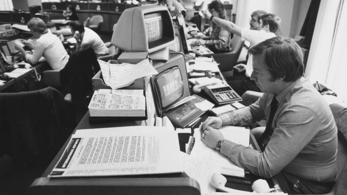 Staff at work at computer screens in a modern office in the City of London, circa 1990. (Photo by Steve Eason/Hulton Archive/Getty Images)