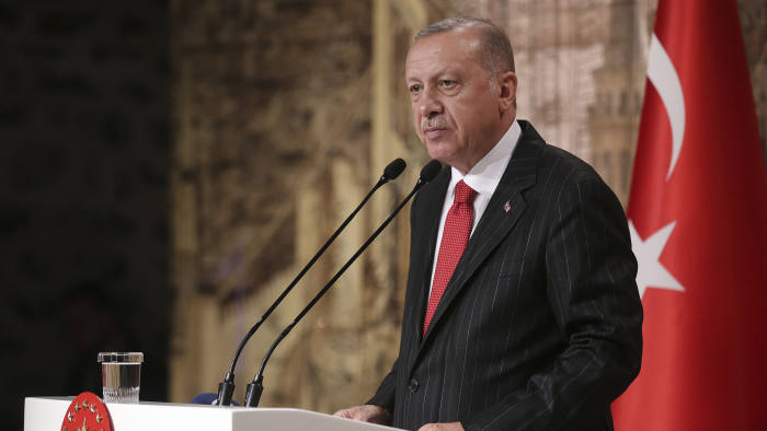 """Turkish President Recep Tayyip Erdogan speaks to the foreign media, in Istanbul, Friday, Oct. 18, 2019. Turkey's president says his country """"cannot forget"""" the harshly worded letter from U.S. President Donald Trump about the Turkish military offensive into Syria. But he says the mutual """"love and respect"""" between the two leaders prevents him from keeping it on Turkey's agenda. (Presidential Press Service via AP, Pool)"""