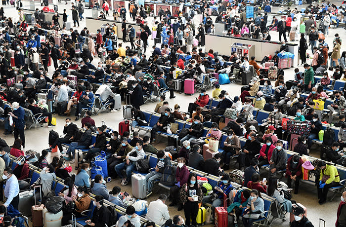 Travellers are seen inside Hankou Railway Station after travel restrictions to leave Wuhan, the capital of Hubei province and China's epicentre of the novel coronavirus disease (COVID-19) outbreak, were lifted, April 8, 2020. REUTERS/Stringer CHINA OUT. TPX IMAGES OF THE DAY - RC2D0G9M2R4V