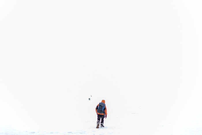 A researcher treks towards a British Antarctic Survey hut at Fossil Bluff