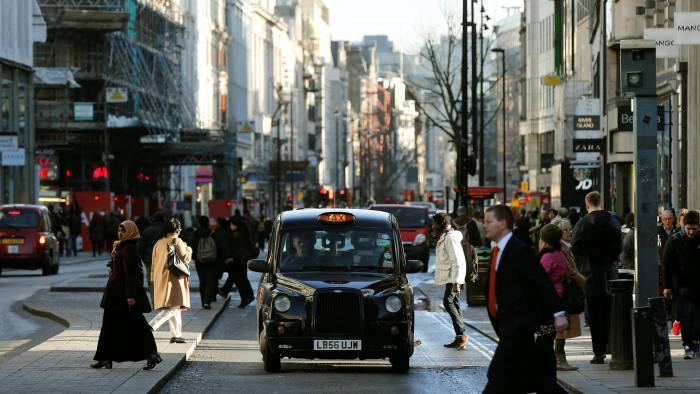 FILE PHOTO: A taxi travels along Oxford Street during a bus strike in London January 13, 2015. REUTERS/Suzanne Plunkett/File Photo