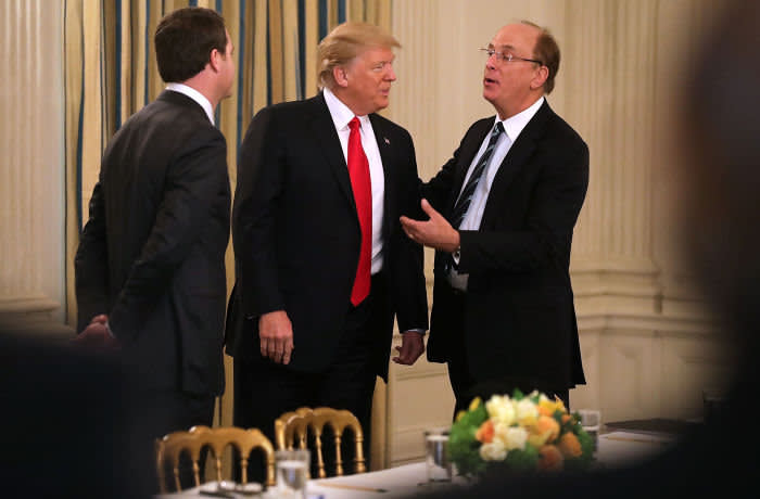 WASHINGTON, DC - FEBRUARY 03: U.S. President Donald Trump (C) greets Wal-Mart Stores CEO Doug McMillon (L) and BlackRock CEO Larry Fink at the beginning of a policy forum in the State Dining Room at the White House February 3, 2017 in Washington, DC. Leaders from the automotive and manufacturing industries, the financial and retail services and other powerful global businesses were invited to the meeting with Trump, his advisors and family. (Photo by Chip Somodevilla/Getty Images)