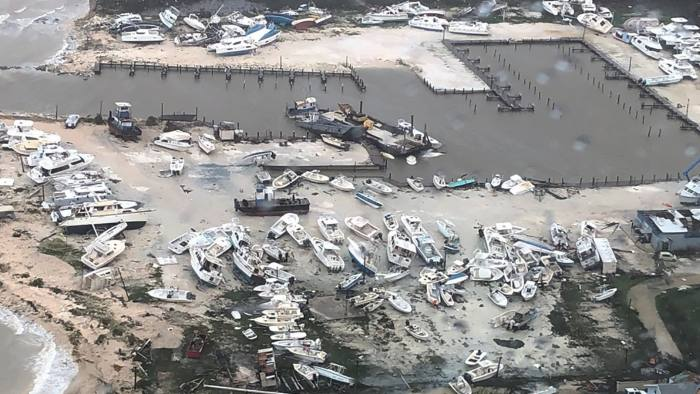 In this Monday, Sept. 2, 2019 photo released by the U.S. Coast Guard Station Clearwater, boats litter the area around marina in the Bahamas after they were tossed around by Hurricane Dorian. The storm pounded away at the islands in a watery onslaught that devastated thousands of homes, trapped people in attics and chased others from one shelter to another. At least five deaths were reported. (U.S. Coast Guard Station Clearwater via AP)