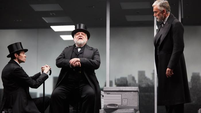 Adam Godley, Simon Russell Beale and Ben Miles in The Lehman Trilogy at the National Theatre A co-production with Neal Street Productions by Stefano Massini adapted by Ben Power Production team Director Sam Mendes Set Designer Es Devlin Costume Designer Katrina Lindsay Video Designer Luke Halls Lighting Designer Jon Clark Music and Sound Nick Powell Movement Polly Bennett Photo by Mark Douet