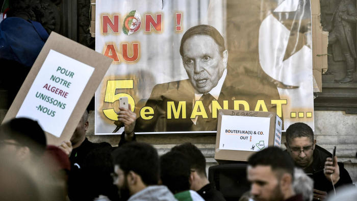 A sign with the image of the Algerian President and which reads, 'No to a 5th mandate' is placed at the base of a statue as protesters rally against the Algerian president's bid for a fifth term in office on February 24, 2019 at the Place de la Republique in Paris. - President Abdelaziz Bouteflika is Algeria's longest-serving president and a veteran of its independence struggle who has clung to power since 1999 despite his ill health. (Photo by STEPHANE DE SAKUTIN / AFP)STEPHANE DE SAKUTIN/AFP/Getty Images