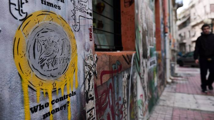 A graffiti in the center of Athens, depicting a Greek euro coin, is seen on February 4, 2015. Greek Finance Minister Yanis Varoufakis told Italian newspaper Il Messaggero in an interview published on February 4 that Athens needed up to six weeks to draw up a global economic plan, as it lobbies its European allies to win backing for debt relief proposals. AFP PHOTO/ LOUISA GOULIAMAKI (Photo credit should read LOUISA GOULIAMAKI/AFP/Getty Images)