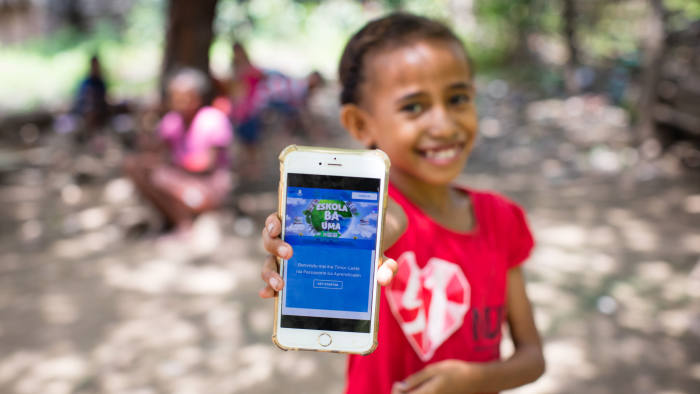 A journey of the mind: a girl in Timor-Leste, where schools closed because of Covid-19, uses the Learning Passport platform developed by Microsoft, UNICEF and the University of Cambridge