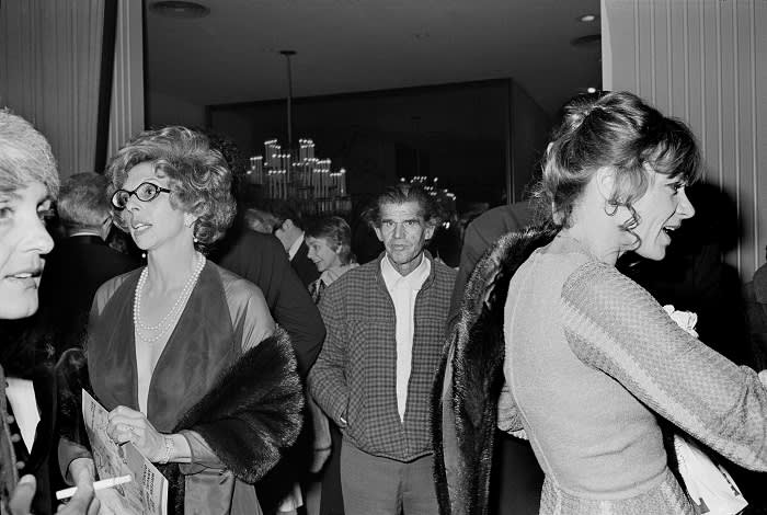 Man walking through a private party, 1973. This picture was displayed at San Francisco's Museum of Modern Art soon after Jang dropped off his prints there in 2002
