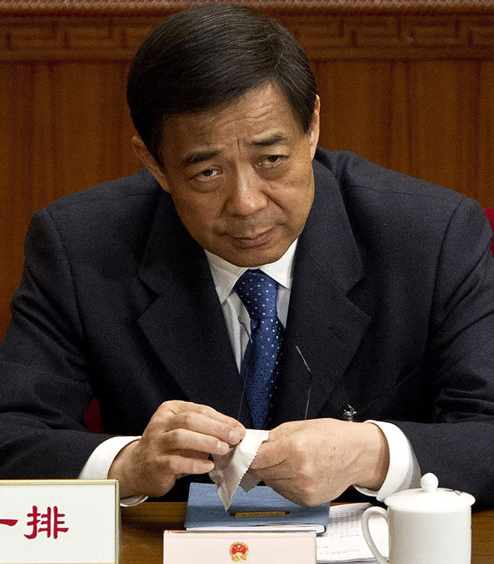 Bo Xilai...FILE - In this file photo taken on March 11, 2012, Chongqing party secretary Bo Xilai attends a plenary session of the National People's Congress at the Great Hall of the People in Beijing. A Chinese court said Sunday Aug. 18, 2013 that Bo Xilai, a rising Communist Party star who fell from power in a messy scandal, will go on trial Thursday on corruption charges. He was dismissed last year in a sandal that saw his wife convicted of killing a British businessman. (AP Photo/Andy Wong, File)