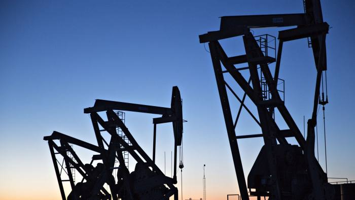 The silhouettes of pumpjacks are seen above oil wells in the Bakken Formation near Dickinson, North Dakota, U.S., on Wednesday, March 7, 2018. When oil sold for $100 a barrel, many oil towns dotting the nation's shale basins grew faster than its infrastructure and services could handle. Since 2015, as oil prices floundered, Williston has added new roads, including a truck route around the city, two new fire stations, expanded the landfill, opened a new waste water treatment plant and started work on an airport relocation and expansion project. Photographer: Daniel Acker/Bloomberg