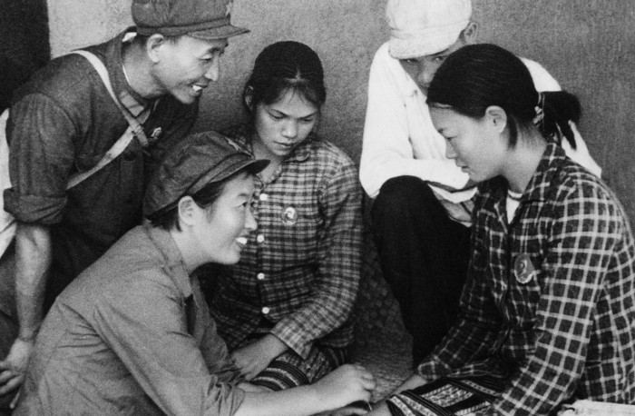 A medical team (Barefoot Doctors) led by communist party member Ma Yi is active in the Wuchih Mountains area, serving the peasants of the Li nationality. Performing acupuncture. China. 1968. Cultural Revolution. (Photo by: Sovfoto/Universal Images Group via Getty Images)