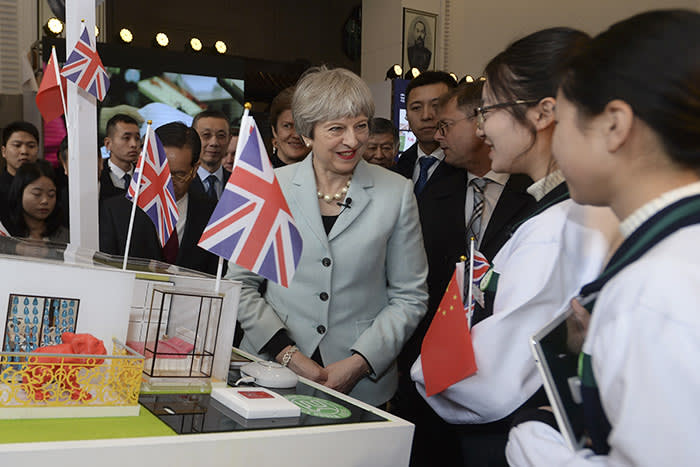 British Prime Minister Theresa May interacts with Chinese youth during a tour to the UK-China Spirit of Youth Festival in Wuhan in central China's Hubei province, Wednesday Jan. 31, 2018. (Chinatopix via AP)