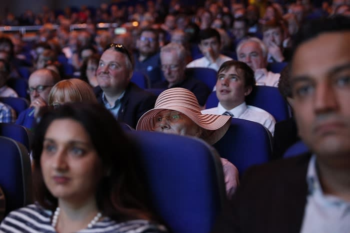 Attendees listen as Boris Johnson, former U.K. foreign secretary and U.K. Conservative party leadership candidate, not pictured, speaks during a hustings event in Birmingham, U.K., on Saturday, June 22, 2019. Front-runnerBoris JohnsonandJeremy Huntare facing Conservative party members for the first time since making it to a two-man runoff to succeed U.K. Prime MinisterTheresa May. Photographer: Darren Staples/Bloomberg