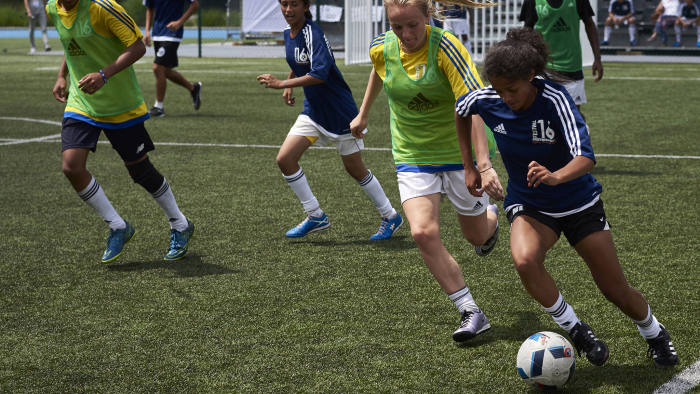 """This photo taken on July 5, 2016 in Lyon shows budding football players playing during the """"Streetfootballworld Festival 16"""", an international solidarity tournament that takes place for the first time during the duration of the UEFA Euro 2016 football championship.  Some 450 girls and boys between 14 and 18 coming from 60 countries, the Brazilian favelas of Rio, shanty towns in India, South African townships and underprivileged European suburbs, meet thanks to """"Streetfootballworld Festival 16"""" aiming at changing the world through football. / AFP / JEAN-PHILIPPE KSIAZEK        (Photo credit should read JEAN-PHILIPPE KSIAZEK/AFP/Getty Images)"""