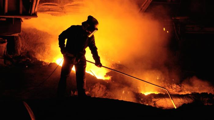 A0P450 Team member taking iron samples using a lance on Blast Furnace No 5 at Corus Port Talbot Steelworks South Wales UK
