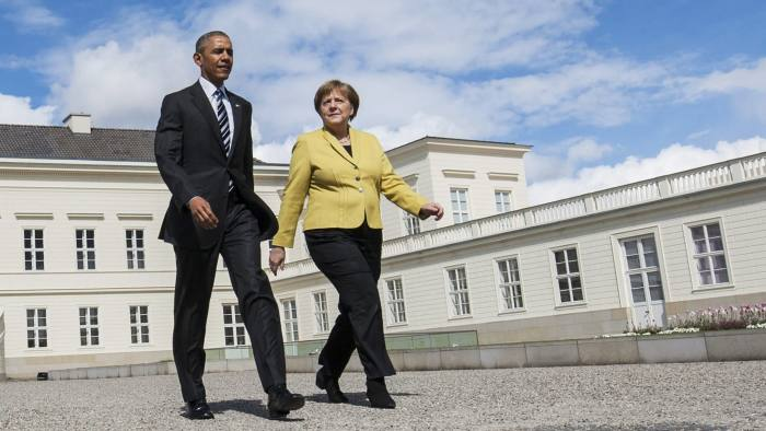 US President Barack Obama and German Chancellor Angela Merkel arrive to inspect a military guard of honour upon arrival at the Herrenhausen Palace in Hanover, on April 24, 2016 where they meet for bilateral talks. Obama is in Germany on the last leg of his tour of Europe and the Gulf, planning to underscore close ties with Chancellor Angela Merkel and make the case for a controversial transatlantic free trade agreement (TTIP). / AFP / POOL / Odd ANDERSEN (Photo credit should read ODD ANDERSEN/AFP/Getty Images)