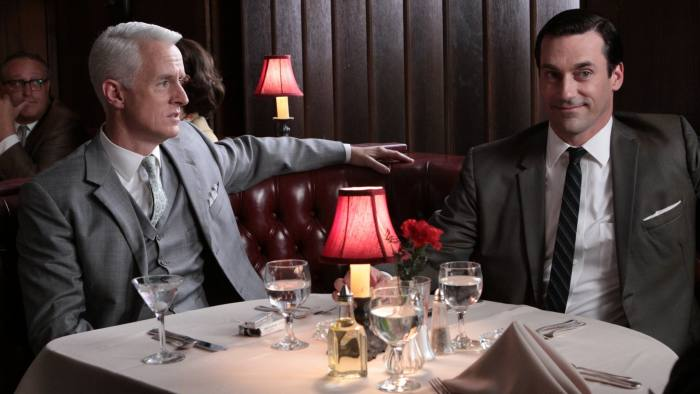 MAD MEN - Series 3 - Episode 2 - Love Among the Ruins - Don is brought in to save the day for a P.R. campaign involving the building of the new Madison Square Garden, only to have the rug pulled out from under him. At home, Betty argues with her brother over how to care for their sick father. - John Slattery as Roger Sterling and Jon Hamm as Don Draper