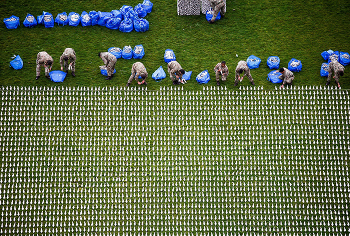 Volunteers from the 1st Battalion of the Royal Anglians help to lay some of the 72,396 shrouded figures that form part of the 'Shroud of the Somme' exhibition in London's Queen Elizabeth Olympic Park, in Stratford, London, Britain November 6, 2018. REUTERS/Henry Nicholls TPX IMAGES OF THE DAY