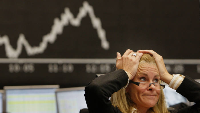 A broker reacts at the stock exchange in Frankfurt, central Germany, on Tuesday Sept. 16, 2008. European stock markets fell again on Tuesday caused by the U.S. financial crisis. (AP Photo/Daniel Roland)
