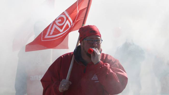 A union member takes part in a warning strike initiated by German union IG Metall on April 29, 2016 at the Volkswagen plant in Zwickau, eastern Germany. The powerful German union IG Metall organised a series of warning strikes overnight, hitting the automobile sector in particular, to turn up heat in wage negotiations for around 3.4 million metal sector workers across the country. / AFP / dpa / Sebastian Willnow / Germany OUT (Photo credit should read SEBASTIAN WILLNOW/AFP/Getty Images)