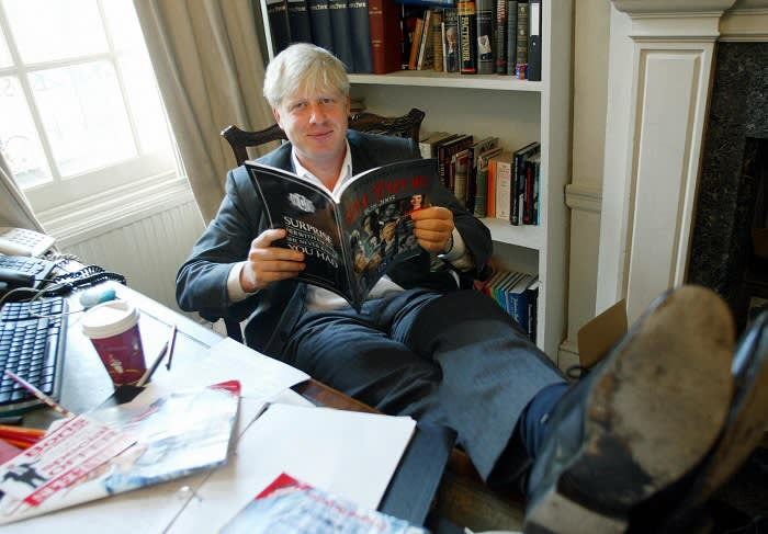 TO GO WITH STORY: LIFESTYLE-BRITAIN-MEDIA. The editor of The Spectator magazine, Boris Johnson, sits in his London office reading the anniversary issue of The Spectator marking 175 years of publication. AFP PHOTO/Jim WATSON (Photo credit should read JIM WATSON/AFP/Getty Images)