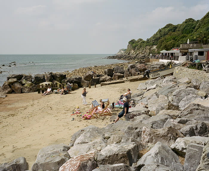 Families on the beach at Steephill Cove, Ventnor, Isle of Wight, June 2018.